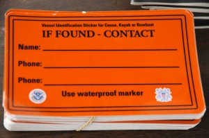 Vessel identification stickers are used to locate the owners of small crafts, such as kayaks, canoes and rowboats, when the vessels get lost or loose from their moorings. An owner should use a water-resistant grease pen to write his or her contact information on the sticker and adhere it to the side of the vessel. Coast Guard photo by Petty Officer 3rd Class Matthew Masaschi.