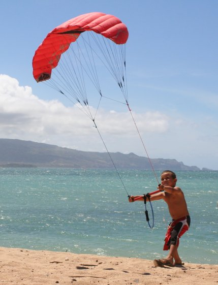 4 year old Trevin flying the trainer kite. www.actionkiteboarding.net